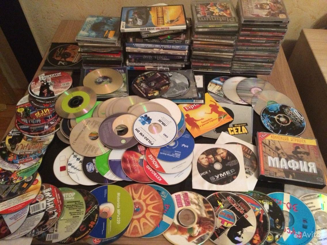 100 дисков с играми, фильмами, музыкой, софтом. Тюменская область,  Тюмень