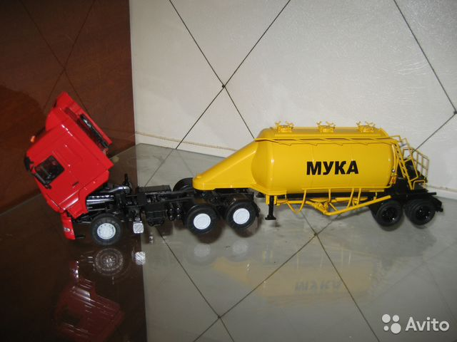 MAZ 6430 Autostore with a semi-trailer ASP a 25 SSM